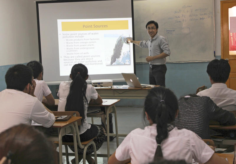 In this Nov. 18, 2012 photo released on June 7, 2013 by Chen Mei, a Laotian teacher instructs the first class of students environmental studies in a classroom at the transitional campus for Soochow University in Vientiane, Laos. It was China's first university campus abroad. Education officials in China are promoting the notion of the country's universities expanding overseas, tapping new education markets while extending the influence of the rising economic power. (AP Photo/Chen Mei)