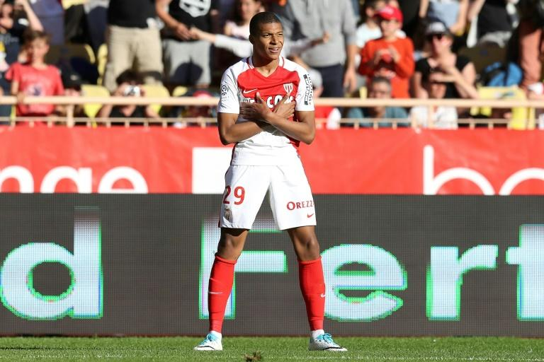 "Monaco's Kylian Mbappe Lottin celebrates after scoring a goal during their French L1 football match against Toulouse on April 29, 2017 at the ""Louis II Stadium"" in Monaco"
