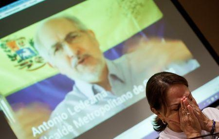 Mitzy Capriles de Ledezma, wife of former Caracas mayor Antonio Ledezma, reacts during a video showing her husband during a news conference in Madrid, Spain August 1, 2017. REUTERS/Sergio Perez