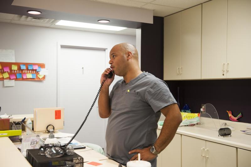 Dalton Johnson, who owns the Huntsville clinic, takes a call from a prospective client and explains the state's waiting period laws. (Chloe Angyal/HuffPost)