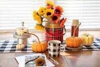 <p>Plaid decorative accents are the perfect foundation for sunflowers and pumpkins. </p>