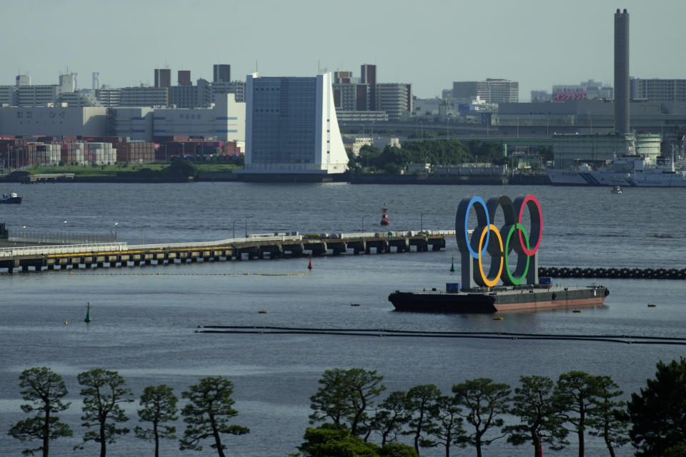 The Olympic Rings float on a barge at Odaiba Marine Park as Tokyo prepares for the 2020 Summer Olympics, Friday, July 16, 2021. The pandemic-delayed games open on July 23 without spectators at most venues. (AP Photo/Charlie Riedel)