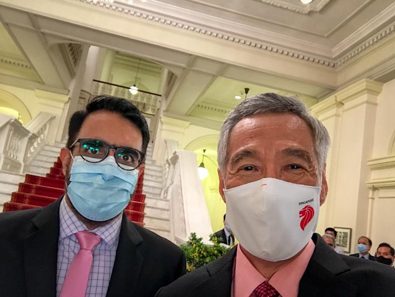 Workers' Party chief Pritam Singh and Prime Minister Lee Hsien Loong at the swearing in ceremony at the Istana on 27 July 2020. (PHOTO: Lee Hsien Loong/Facebook)