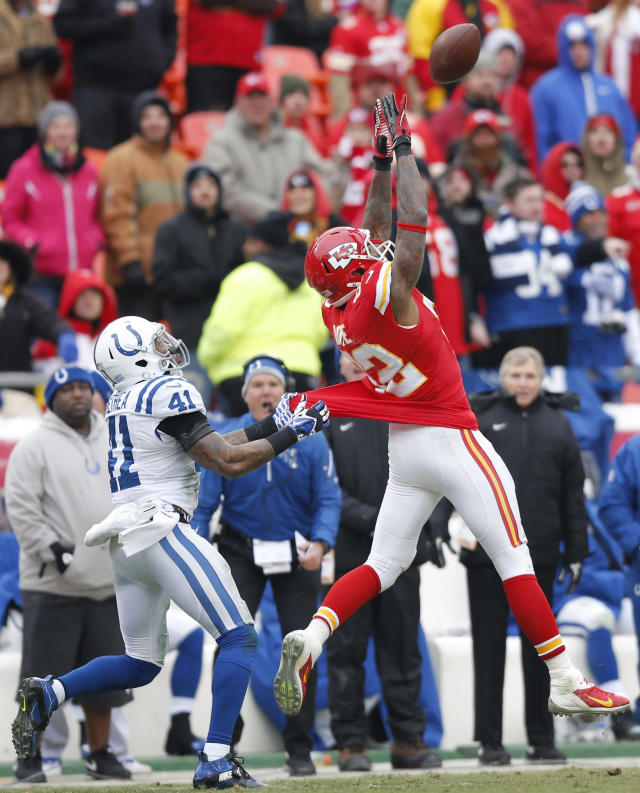 Indianapolis Colts strong safety Antoine Bethea (41) hangs on to Kansas City Chiefs wide receiver Dwayne Bowe (82) during the second half of an NFL football game at Arrowhead Stadium in Kansas City, Mo., Sunday, Dec. 22, 2013. The pass was ruled incomplete on the play. (AP Photo/Ed Zurga)
