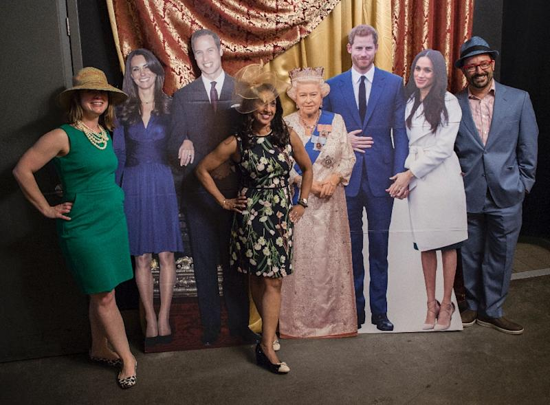 Patrons of a Washington bar celebrating this weekend's highly anticipated wedding pose with lifesize cutouts of the royal family (AFP Photo/Andrew CABALLERO-REYNOLDS)