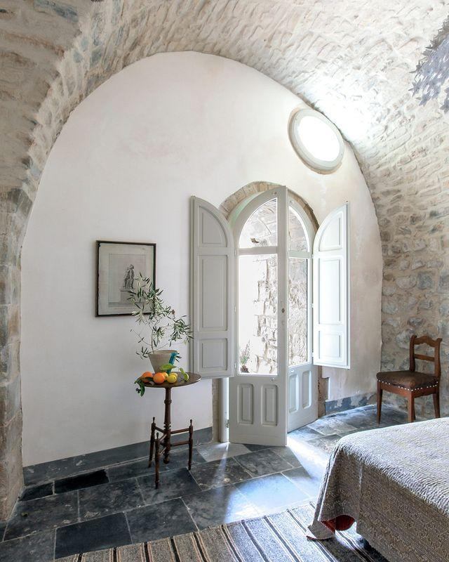 "<p>Vaulted stone ceilings reflect the bright Italian sunshine in this re-imagined Modica home designed by Bill Brockshmidt and Richard Dragisic. </p><p><a class=""link rapid-noclick-resp"" href=""https://www.elledecor.com/design-decorate/house-interiors/a31978243/brockschmidt-palazzo-sicily/"" rel=""nofollow noopener"" target=""_blank"" data-ylk=""slk:TOUR THE HOME"">TOUR THE HOME</a></p><p><a href=""https://www.instagram.com/p/CDZCSl0Hywe/"" rel=""nofollow noopener"" target=""_blank"" data-ylk=""slk:See the original post on Instagram"" class=""link rapid-noclick-resp"">See the original post on Instagram</a></p>"