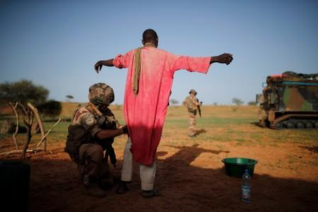 The Wider Image: French troops in Mali campaign face storms, mud, mistrust