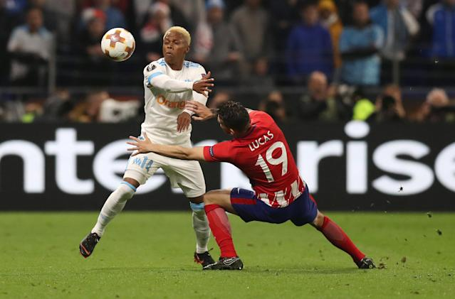 Soccer Football - Europa League Final - Olympique de Marseille vs Atletico Madrid - Groupama Stadium, Lyon, France - May 16, 2018 Marseille's Clinton Njie in action with Atletico Madrid's Lucas Hernandez REUTERS/Peter Cziborra