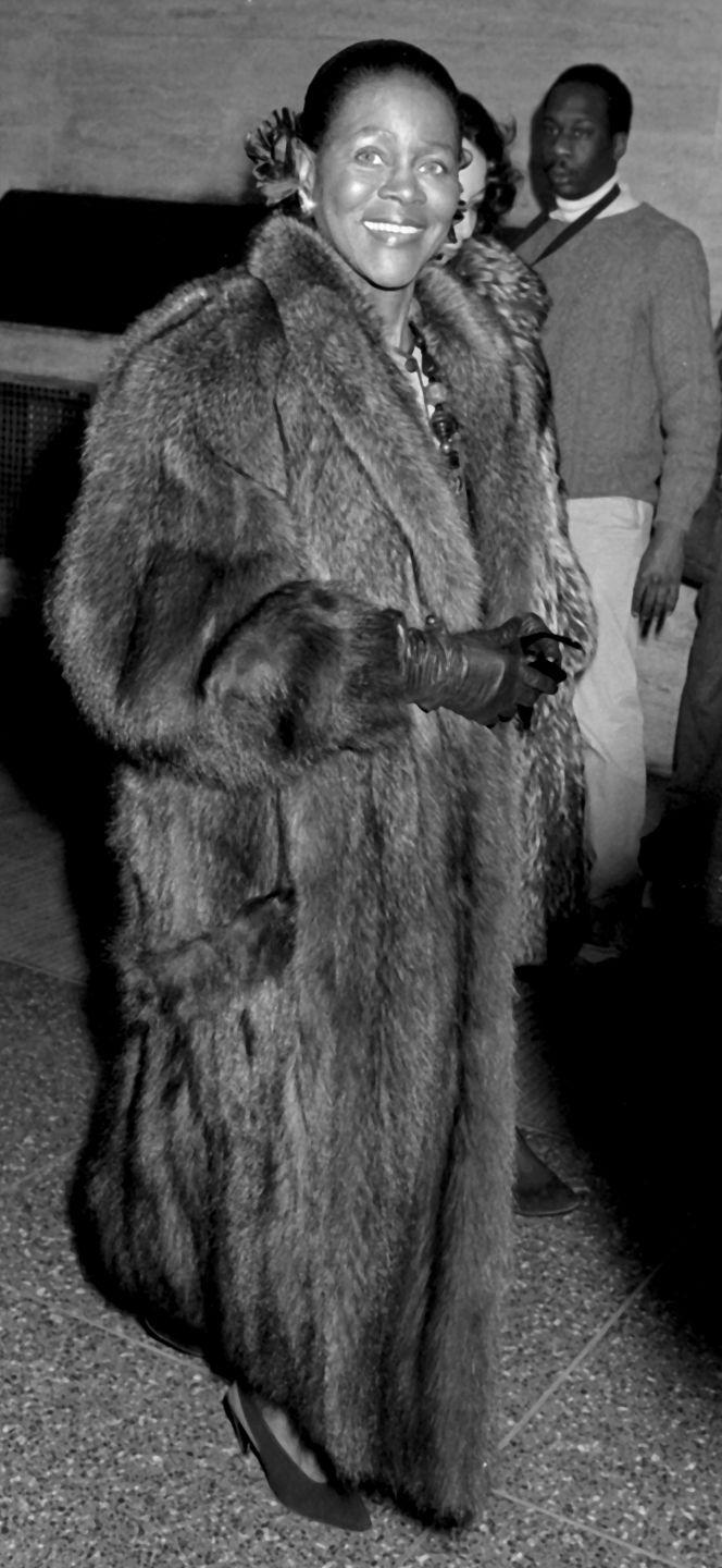 <p>Very few people rock a fur like Ms. Tyson. Here, Cicely heads inside the Willi Smith fashion in a floor-length mink complete leather gloves and slingback heels.</p>