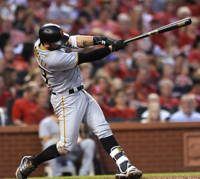 Pittsburgh Pirates' Francisco Cervelli follows through with a triple against the St. Louis Cardinals during the fifth inning of a baseball game Friday, June 1, 2018, at Busch Stadium in St. Louis. (AP Photo/Bill Boyce)