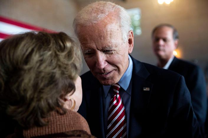 Former Vice President Joe Biden talks to a woman in the crowd after giving remarks during a campaign event on Wednesday, Oct. 23, 2019, in West Point.
