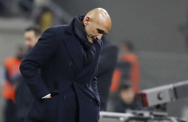 Inter Milan coach Luciano Spalletti looks down during the Serie A soccer match between Inter Milan and Benevento at the San Siro stadium in Milan, Italy, Saturday, Feb. 24, 2018. (AP Photo/Antonio Calanni)
