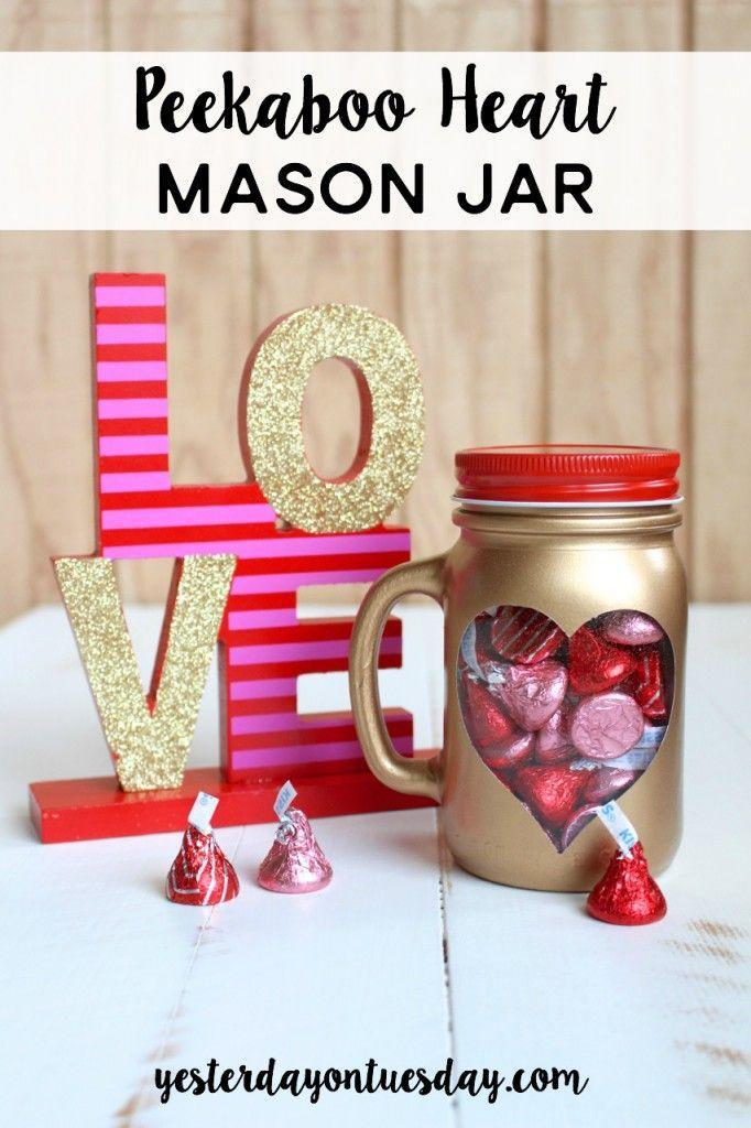 """<p>Fill this beautiful gold mason jar with <a href=""""https://www.countryliving.com/food-drinks/g1605/heart-shaped-desserts-valentines-day/"""" rel=""""nofollow noopener"""" target=""""_blank"""" data-ylk=""""slk:Valentine's Day treats"""" class=""""link rapid-noclick-resp"""">Valentine's Day treats</a> that will make your other half smile.</p><p><strong>Get the tutorial at <a href=""""http://yesterdayontuesday.com/2017/01/peekaboo-heart-mason-jar/"""" rel=""""nofollow noopener"""" target=""""_blank"""" data-ylk=""""slk:Yesterday on Tuesday"""" class=""""link rapid-noclick-resp"""">Yesterday on Tuesday</a>.</strong></p><p><a class=""""link rapid-noclick-resp"""" href=""""https://www.amazon.com/Betrome-Handles-Drinking-Silver-Bundle/dp/B08LDC3RB2/ref=sr_1_12?tag=syn-yahoo-20&ascsubtag=%5Bartid%7C10050.g.93%5Bsrc%7Cyahoo-us"""" rel=""""nofollow noopener"""" target=""""_blank"""" data-ylk=""""slk:SHOP MASON JAR MUGS"""">SHOP MASON JAR MUGS</a></p>"""