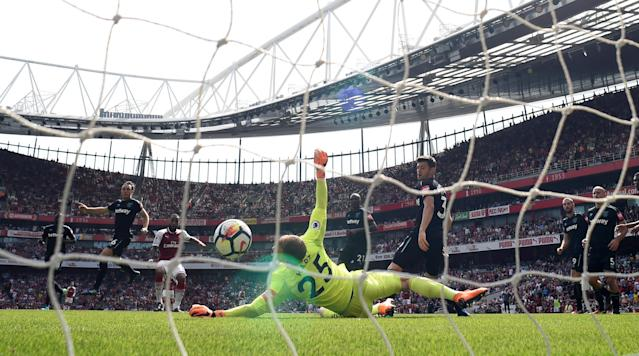 """Soccer Football - Premier League - Arsenal v West Ham United - Emirates Stadium, London, Britain - April 22, 2018 Arsenal's Alexandre Lacazette scores their fourth goal Action Images via Reuters/Tony O'Brien EDITORIAL USE ONLY. No use with unauthorized audio, video, data, fixture lists, club/league logos or """"live"""" services. Online in-match use limited to 75 images, no video emulation. No use in betting, games or single club/league/player publications. Please contact your account representative for further details."""