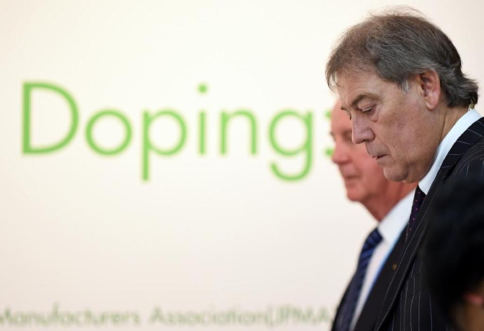 """World Anti-Doping Agency director general David Howman (R), pictured on January 28 2015, said it would be """"reckless to draw conclusions on the basis of limited information"""" following allegations of mass doping (AFP Photo/Toshifumi Kitamura)"""