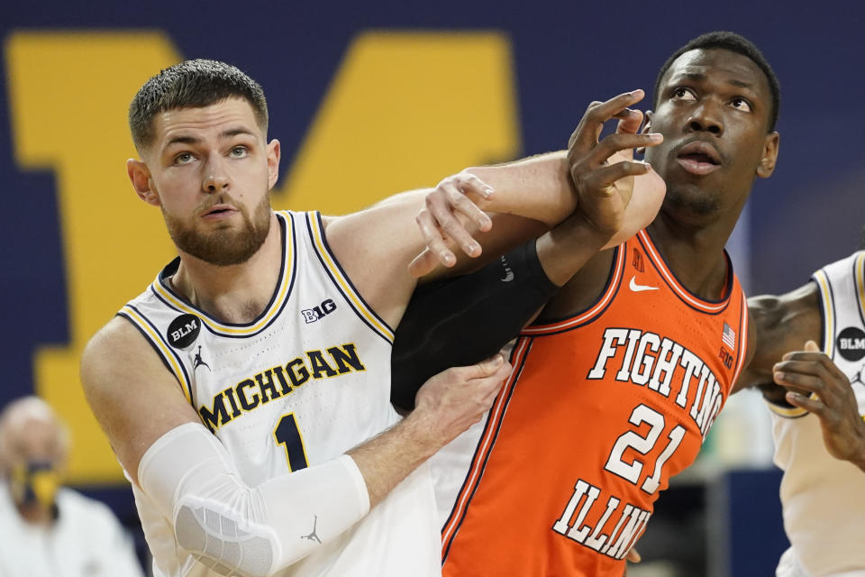 Michigan center Hunter Dickinson (1) and Illinois center Kofi Cockburn (21) battle for position in the first half of an NCAA college basketball game in Ann Arbor, Mich., Tuesday, March 2, 2021. (AP Photo/Paul Sancya)