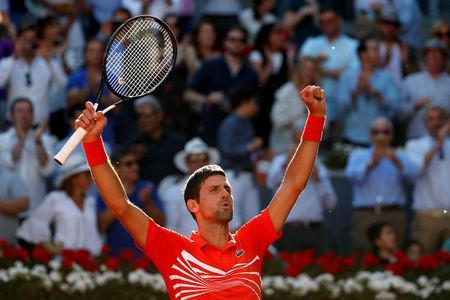 Tennis - ATP 1000 - Madrid Open - The Caja Magica, Madrid, Spain - May 11, 2019 Serbia's Novak Djokovic celebrates winning his semi final match against Austria's Dominic Thiem REUTERS/Susana Vera