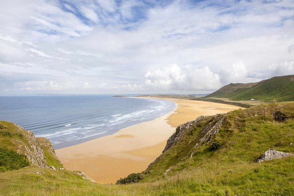 "<p>Rhossili Bay in the Gower was voted the best beach in the UK in 2010, and unsurprisingly has made the list regularly ever since. It's three miles long, and welcomes dogs, hikers, families and surfers.</p><p><a class=""link rapid-noclick-resp"" href=""https://go.redirectingat.com?id=127X1599956&url=https%3A%2F%2Fwww.booking.com%2F&sref=https%3A%2F%2Fwww.cosmopolitan.com%2Fuk%2Fentertainment%2Ftravel%2Fg4958%2Fbest-beaches-in-uk%2F"" rel=""nofollow noopener"" target=""_blank"" data-ylk=""slk:FIND ACCOMMODATION"">FIND ACCOMMODATION </a></p>"