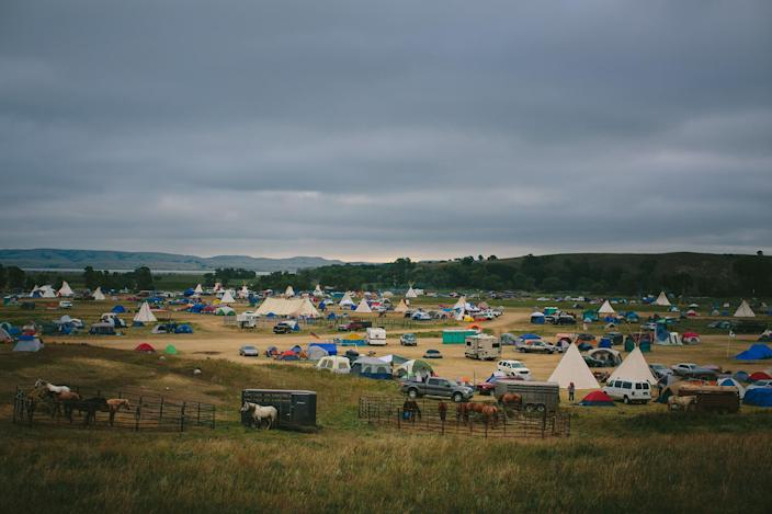 <p>The Seven Council camp is seen near the Cannon Ball River, part of a historic gathering of more than a hundred Native American tribes from across North America, to protest against the pipeline they fear will poison the Missouri River, which runs through the Standing Rock Sioux reservation, in North Dakota on Sept. 6, 2016. (Photo: Alyssa Schukar for Yahoo News) </p>