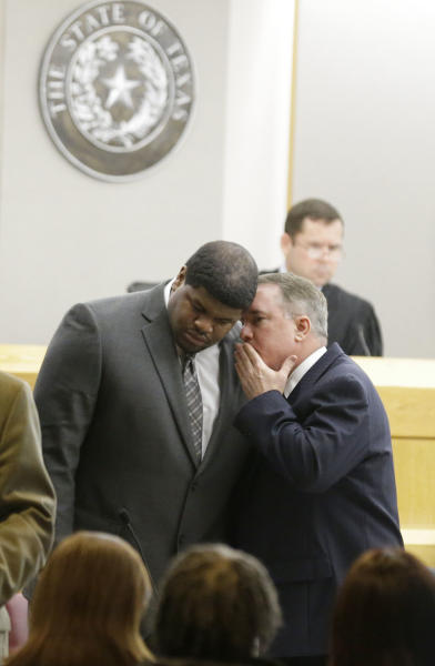 Former Dallas Cowboys' Josh Brent, left, listens to his attorney George Milner during juror selection Friday, Jan. 10, 2014, in Dallas. Jury selection continues for the upcoming trial of Brent, who's accused of killing a practice squad player in a drunken-driving wreck. Opening statements in the case are expected next week. (AP Photo/LM Otero)