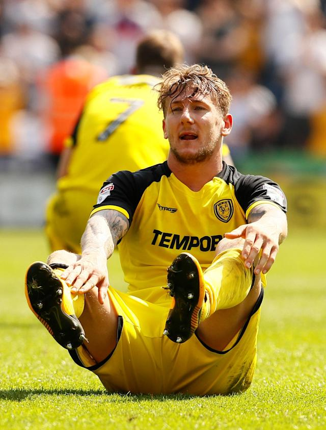 "Soccer Football - Championship - Preston North End vs Burton Albion - Deepdale, Preston, Britain - May 6, 2018 Burton Albion's Kyle McFadzean looks dejected at full time Action Images/Jason Cairnduff EDITORIAL USE ONLY. No use with unauthorized audio, video, data, fixture lists, club/league logos or ""live"" services. Online in-match use limited to 75 images, no video emulation. No use in betting, games or single club/league/player publications. Please contact your account representative for further details."