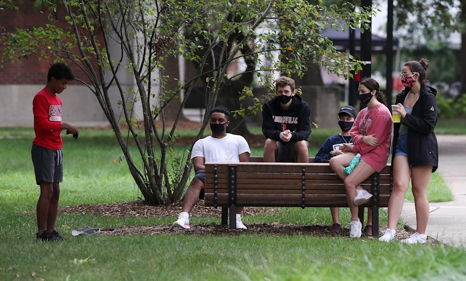 U of L students relax on the Belknap campus as the fall semester begins with CDC guidelines in place to protect students and staff from exposure to Covid-19 on Aug. 18, 2020.