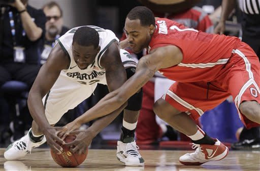 Michigan State forward Draymond Green, left, and Ohio State forward Deshaun Thomas scramble for a loose ball in the first half of an NCAA college basketball game in the final of the Big Ten Conference men's tournament in Indianapolis, Sunday, March 11, 2012. (AP Photo/Michael Conroy)