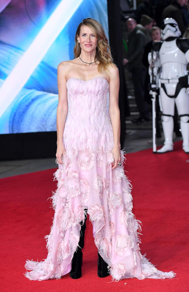 <p>Dern mixed sweet — a pink high-low hem dress with feather embellishing from Alexander McQueen — with some badass knee-high boots. (Photo: Getty Images) </p>
