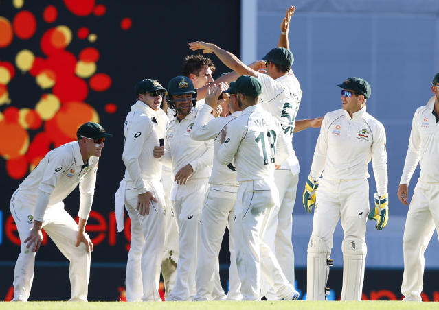 Australia celebrate the wicket of Pakistan's Asad Shafiq during their cricket test match in Brisbane, Australia, Saturday, Nov. 23, 2019. (AP Photo/Tertius Pickard)