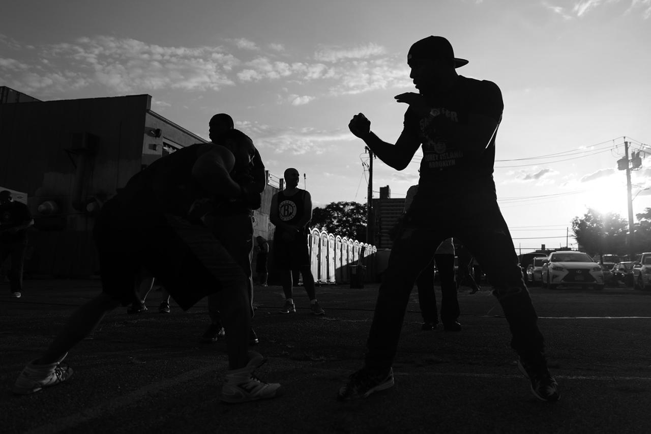 <p>A fighter works out with his trainer before the Brooklyn Smoker in the parking lot of Gargiulo's Italian restaurant in Coney Island, Brooklyn, on Aug. 24, 2017. (Photo: Gordon Donovan/Yahoo News) </p>
