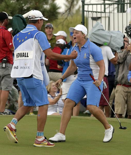Europe's Caroline Hedwall of Sweden, right, celebrates with her caddie Henrik Hilford Brander after making a birdie putt on the 18th hole to give her the win over United States' Michelle Wie during the singles matches at the Solheim Cup golf tournament Sunday, Aug. 18, 2013, in Parker, Colo. The win gave Europe 14 points and they retained the Solheim Cup. (AP Photo/Chris Carlson)