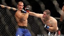Cain Velasquez punches Junior dos Santos during their fight at UFC 155. (Courtesy: Tracy Lee for Y! Sports)