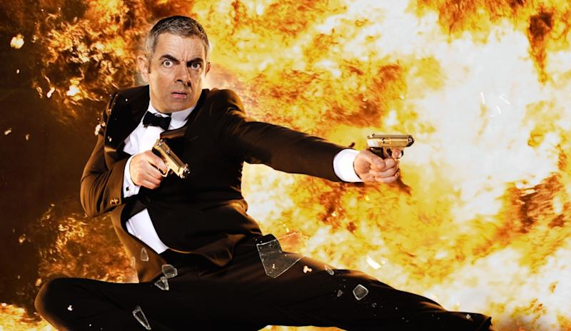 Rowan Atkinson exploding onto the screen in 2011's 'Johnny English Reborn' (credit: Universal)