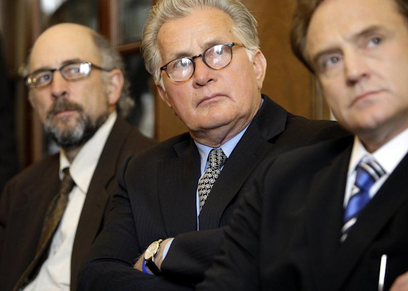 """FILE - In this March 31, 2009 file photo, actors from """"The West Wing"""" from left,  Richard Schiff, Martin Sheen, and Bradley Whitford prepare to speak on Capitol Hill in Washington during an event supporting the """"Faces of the Employee Free Choice Act,"""" campaign. For seven years, from 1999 to 2006, the NBC drama """"The West Wing"""" showed America the inner workings of President Josiah Bartlet's made-up White House. Re-watching its episodes today, it's difficult to ignore the parallels between the fiction of then and the reality of today. Since the show ended, the line between the authentic and the packaged in Washington seems to have grown increasingly fuzzy, not just in our politics but now, also, in governing itself. (AP Photo/Haraz N. Ghanbari, File)"""