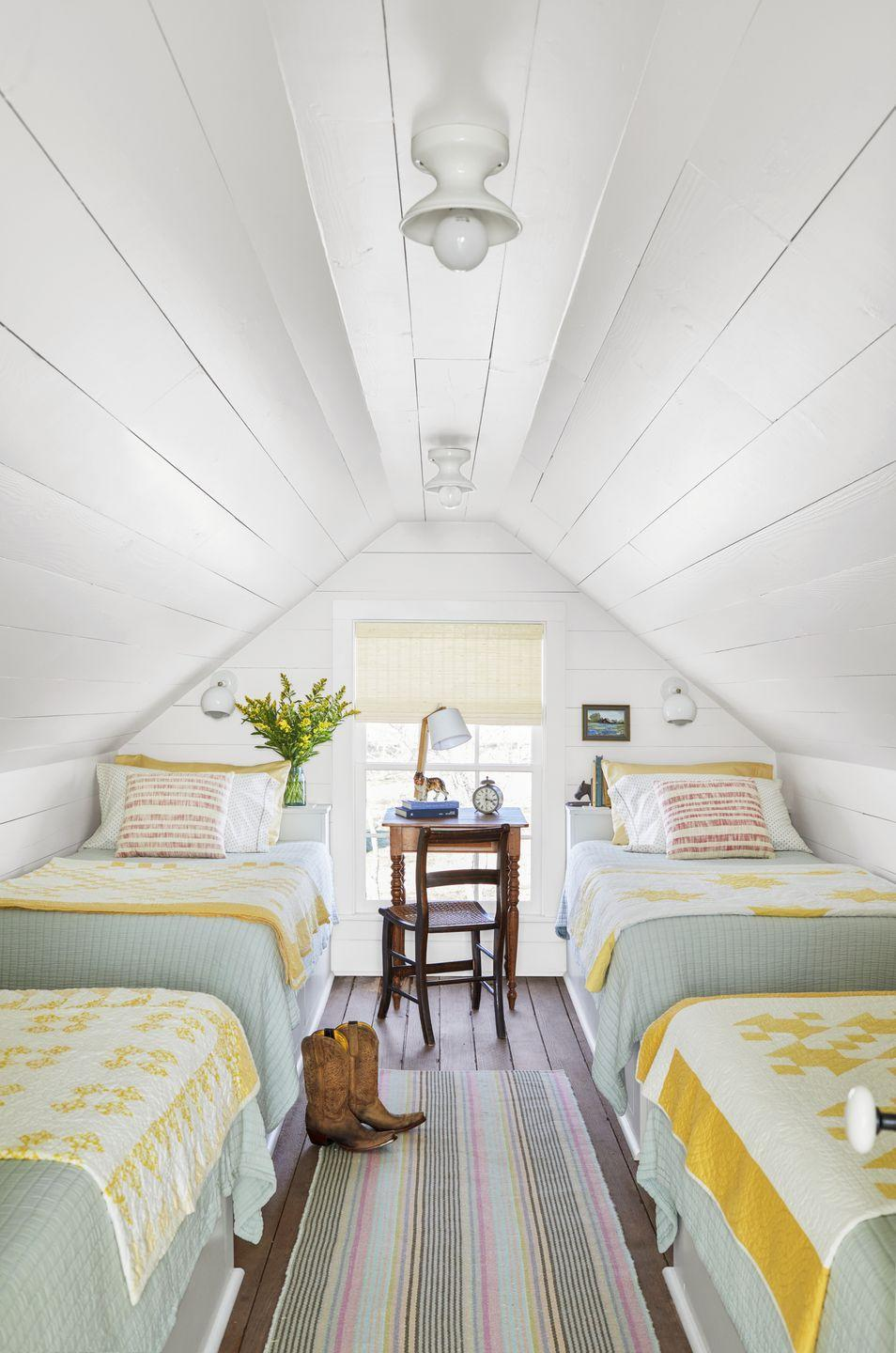 """<p>The easiest way to make a small bedroom look large is to paint everything the same crisp white. The tiny attic bedroom in this Texas farmhouse measures just 170-square-feet, but feels as airy and spacious as a room twice its size. To enhance a small space, keep most furnishings on the light side, but then layer in a few pops of happy color to add personality. <strong><br><br>Get the Look: </strong><br>Wall Paint Color: <a href=""""https://www.sherwin-williams.com/homeowners/color/find-and-explore-colors/paint-colors-by-family/SW7551-greek-villa"""" rel=""""nofollow noopener"""" target=""""_blank"""" data-ylk=""""slk:Greek Villa by Sherwin-Williams"""" class=""""link rapid-noclick-resp"""">Greek Villa by Sherwin-Williams</a></p>"""