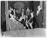<p>A group of clowns sit around, posing for a photograph, while off-duty at a London circus.</p>