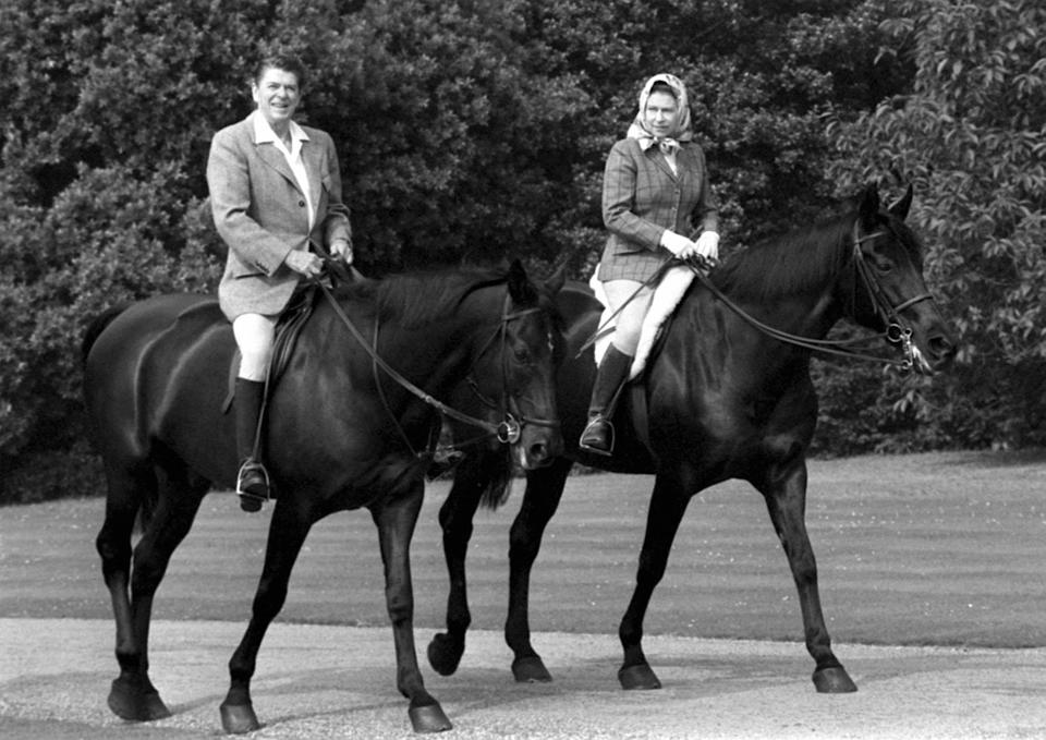 EMBARGOED TO 2230 SUNDAY MAY 31 File photo dated 8/6/1982 of US President Ronald Reagan goes riding in Windsor Home Park while staying as a guest of Queen Elizabeth II. The Queen has been seen riding her horse this weekend in Windsor Home Park as she has been in residence at Windsor Castle during the coronavirus pandemic.