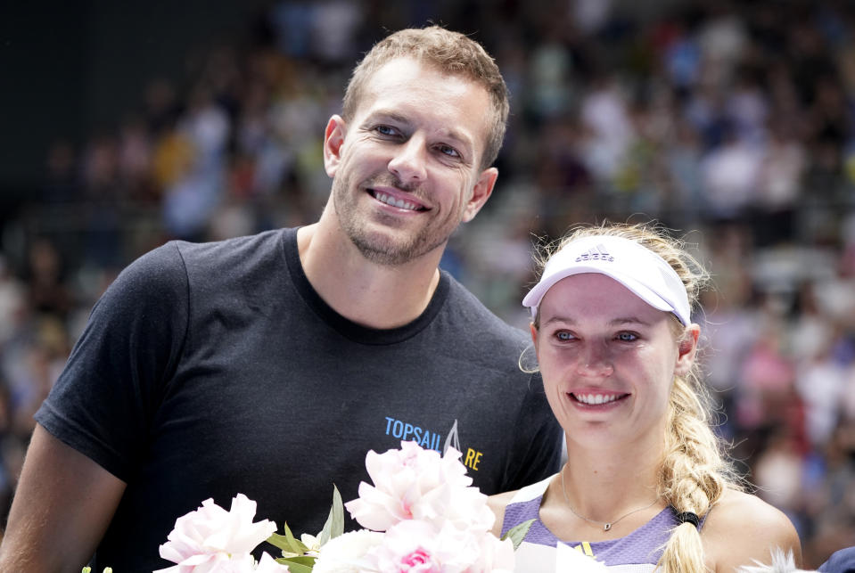 Tennis - Australian Open - Third Round - Melbourne Park, Melbourne, Australia - January 24, 2020 - Denmark's Caroline Wozniacki poses with her husband David Lee as she heads into retirement after losing the match against Tunisia's Ons Jabeur. REUTERS/Kim Hong-Ji