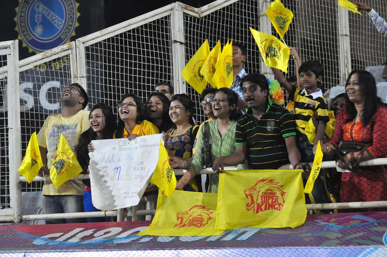 Cricket fans cheer during the Champions League T20, 10th match, Group B, between Chennai Super Kings and Sunrisers Hyderabad t JSCA International Cricket Stadium, Ranchi on Sept. 26, 2013. (Photo: IANS)