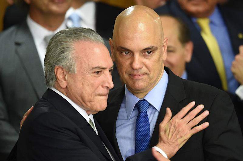 Brazilian acting President Michel Temer (L) and his new Minister of Justice Alexandre de Moraes gesture during the inauguration ceremony of the new ministers at Planalto Palace, in Brasilia, on May 12, 2016