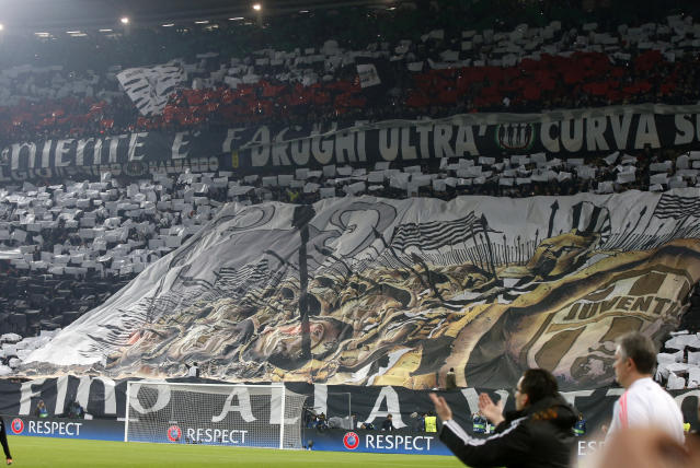 FILE - In this Feb. 23, 2016 file photo, Juventus fans unveil a giant banner prior to the Champions League, round of 16, first-leg soccer match between Juventus and Bayern Munich at the Juventus stadium in Turin, Italy. On Monday, Sept. 16, 2019 said they have arrested 12 hard-core Juventus ultra fan leaders for a series of accusations, including making illegal demands to the club in order to obtain more tickets. (AP Photo/Luca Bruno, files)