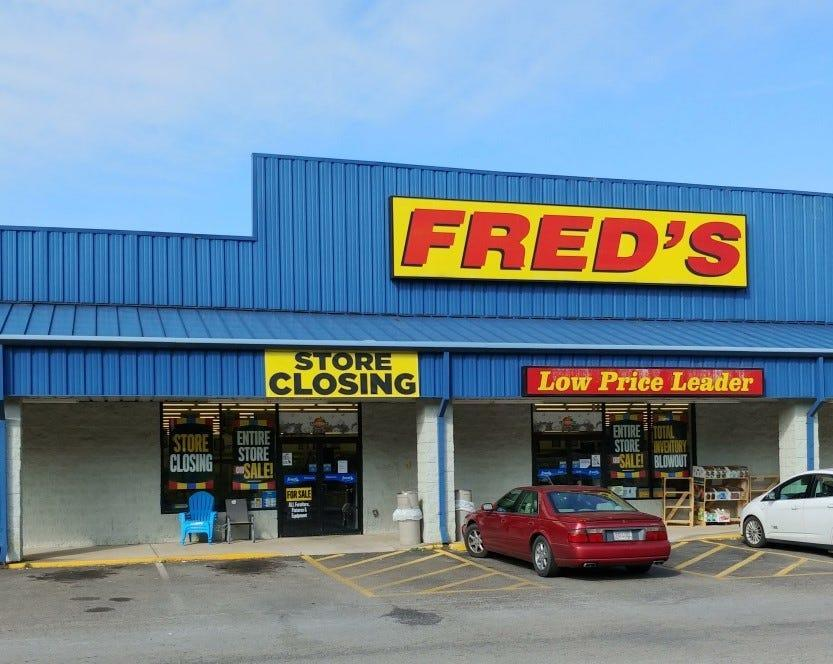 Discount merchandise retailer Fred's is closing another 129 stores as the company's swift contraction continues, placing its survival in doubt.