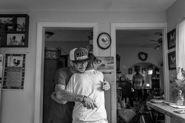 <p>Recovering heroin addict Larry Fugate, hugs his mom Terri Fugate at their home in Middletown, Ohio. (Photograph by Mary F. Calvert for Yahoo News) </p>