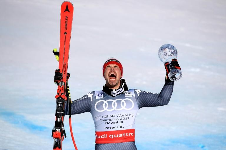 Peter Fill of Italy celebrates with the season-ending globes after finishing second in the Men's Downhill for the 2017 Audi FIS Ski World Cup Final at Aspen Mountain on March 15, 2017