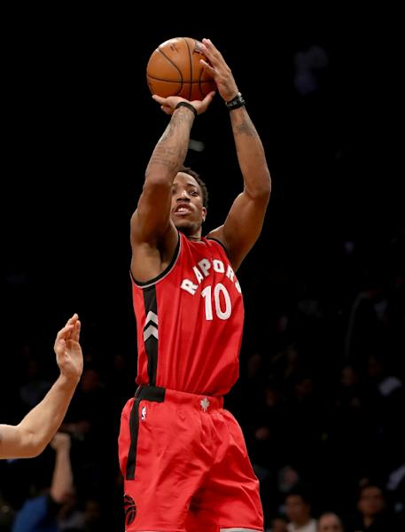 DeMar DeRozan of the Toronto Raptors takes a shot during a NBA game at the Barclays Center in New York, on January 17, 2017 (AFP Photo/ELSA)