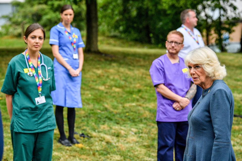 GLOUCESTER, ENGLAND - JUNE 16: Camilla, Duchess of Cornwall chats with NHS staff and front line key workers who who have responded to the COVID-19 pandemic during a visit to Gloucestershire Royal Hospital on June 16, 2020 in Gloucester, England. (Photo by WPA Pool-Ben Birchall/Getty Images)