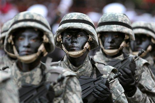 Soldiers march during a military parade marking Peru's Independence Day in Lima, Peru, Sunday, July 29, 2012. (AP Photo/Karel Navarro)