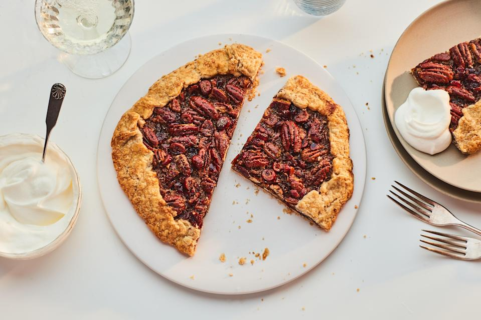 """A whole pecan pie is a lot of work if you're just serving dessert to two or four people. Instead, make this elegant little galette studded with whiskey-soaked cranberries. <a href=""""https://www.epicurious.com/recipes/food/views/pecan-cranberry-galette?mbid=synd_yahoo_rss"""" rel=""""nofollow noopener"""" target=""""_blank"""" data-ylk=""""slk:See recipe."""" class=""""link rapid-noclick-resp"""">See recipe.</a>"""