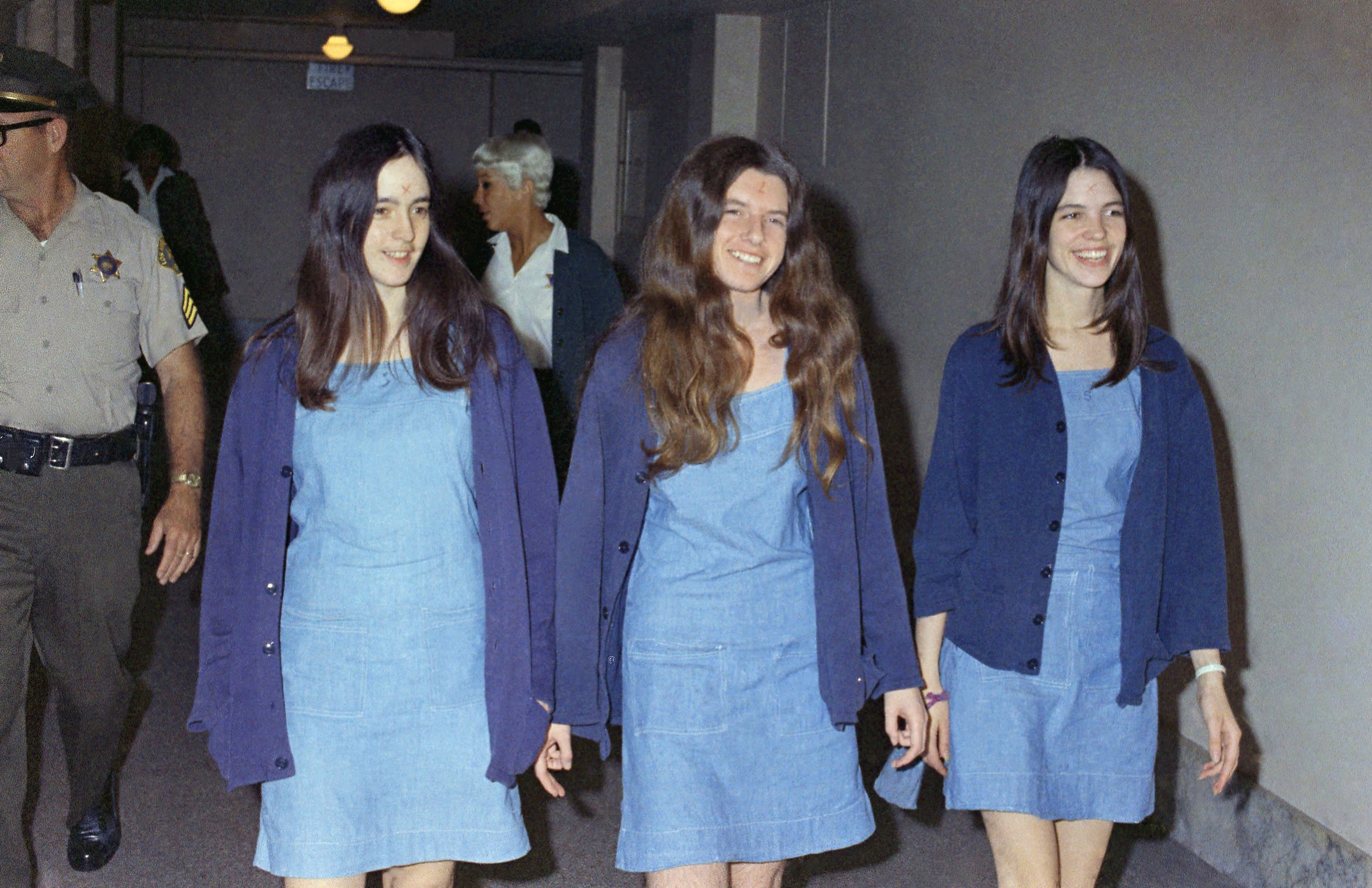 In this Aug. 20, 1970, file photo, Charles Manson followers, from left, Susan Atkins, Patricia Krenwinkel and Leslie Van Houten walk to court to appear for their roles in the 1969 cult killings of seven people in Los Angeles.
