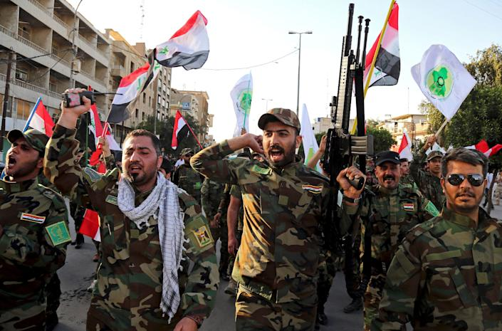 Iraqi Shiites from the Badr forces militia protest against the military intervention in Yemen, in Baghdad, Iraq in 2015. (Photo: Karim Kadim/AP) (Photo: ASSOCIATED PRESS)